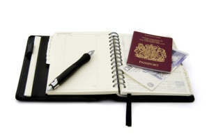 Passport with diary open on expenses page