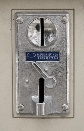 Old metal coin slot panel from a coin operated machine
